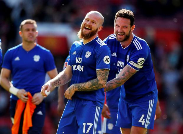Cardiff City's Aron Gunnarsson celebrates after the match with Sean Morrison. Photo: Lee Smith/Action Images via Reuters