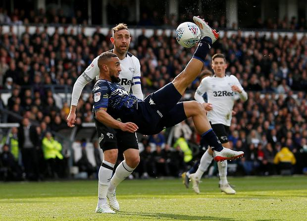 Leeds United's Kemar Roofe shoots at goal with an overhead kick. Photo: Craig Brough/Action Images via Reuters