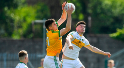 Meath's Adam Flanagan battles for possession with Offaly's Johnny Moloney. Photo by Brendan Moran/Sportsfile