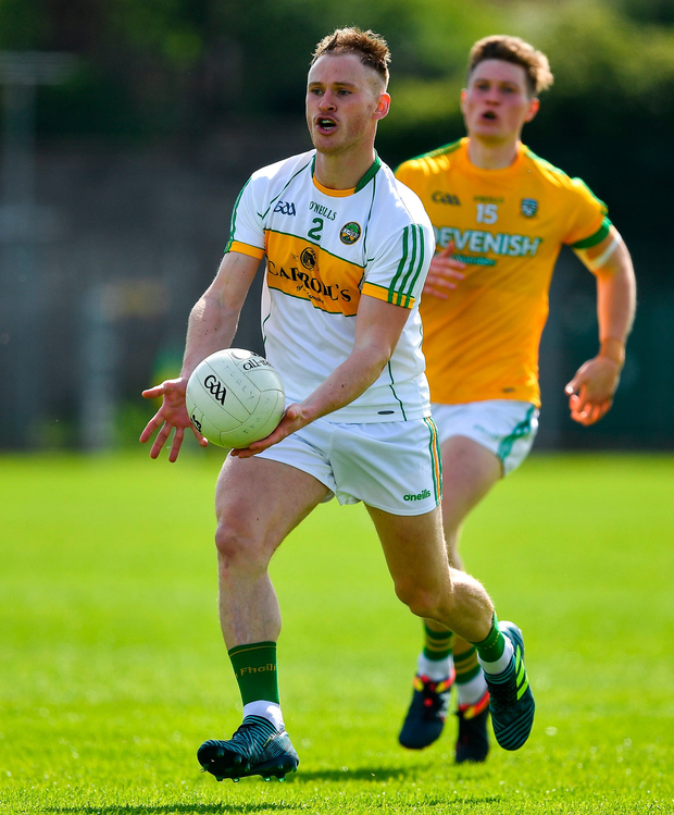 Declan Hogan of Offaly in action against Thomas O'Reilly of Meath. Photo by Brendan Moran/Sportsfile