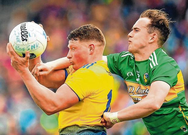 Conor Cox of Roscommon in action against Micheal McWeeney of Leitrim. Photo: Seb Daly/Sportsfile