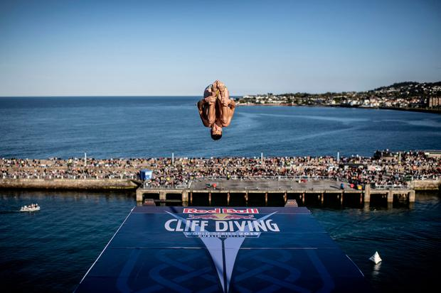 Leap of faith: Oleksiy Prygorov of the Ukraine dives from the 27-metre platform at Dún Laoghaire Harbour. Photo: Getty
