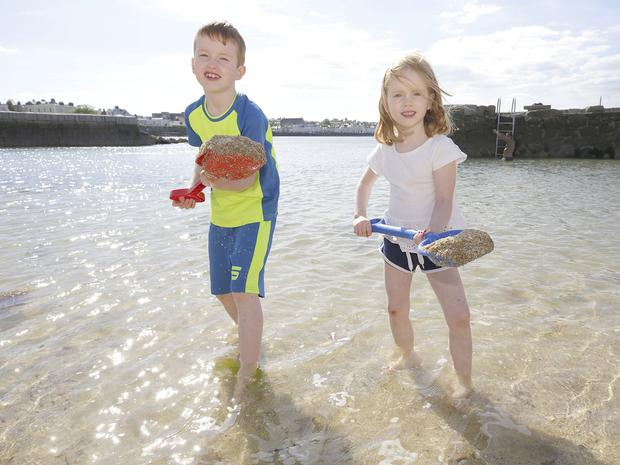 Fun in the sun: Left, Liam Thompson (7) and his sister Aisling (5) at Sandycove, Dublin