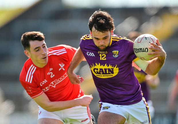 Conor Devitt of Wexford in action against Fergal Donohoe of Louth. Photo: Matt Browne/Sportsfile