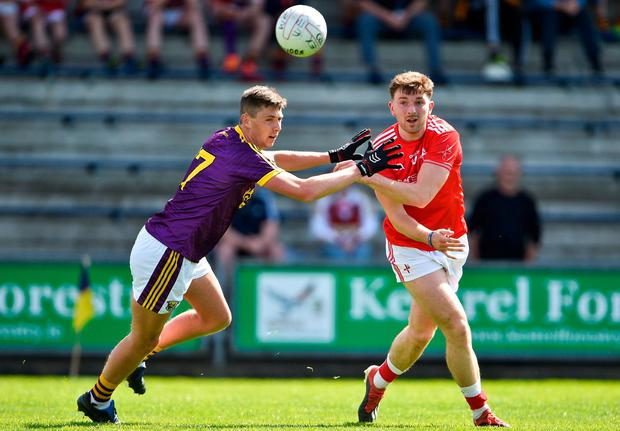 Sam Mulroy of Louth in action against Gavin Sheehan of Wexford. Photo: Matt Browne/Sportsfile