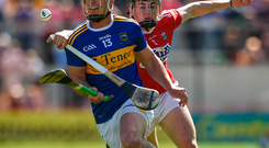 John O'Dwyer of Tipperary in action against Darragh Fitzgibbon of Cork