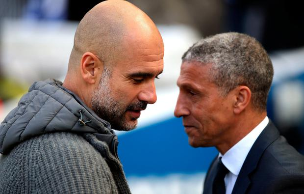 Manchester City manager Pep Guardiola with Chris Hughton on Sunday