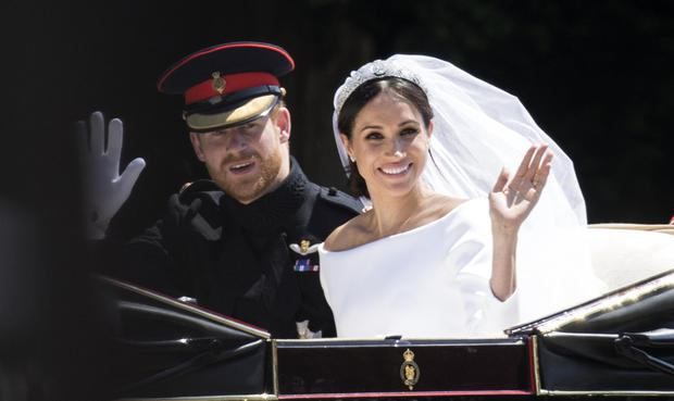 Prince Harry, Duke of Sussex and Meghan, Duchess of Sussex travel in the Ascot Landau Carriage during their carriage procession after their wedding on May 19, 2018 in Windsor, England