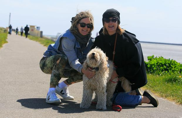 (L to R) Sarah Shannon & Margo Shannon, both from Clonskeagh, with Millie the dog enjoying the good weather at Dollymount Beach, Dublin last month. Photo: Gareth Chaney Collins