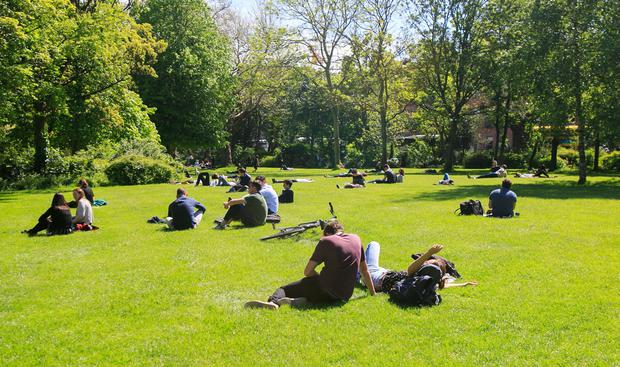 People enjoying the good weather in Merrion Square, Dublin. Photo: Gareth Chaney Collins