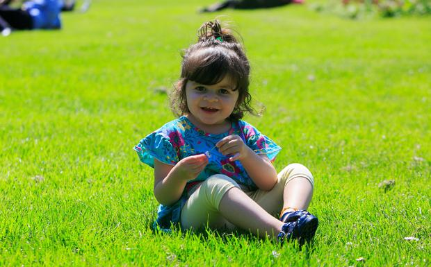 Liz Silveria (2), from Knocklyon, enjoying the good weather in Merrion Square, Dublin. Photo: Gareth Chaney Collins