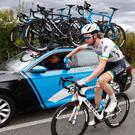 National road race champion Conor Dunne gets a bottle from his team car during today's 3rd stage of the giro d'Italia.