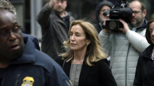 Felicity Huffman arrives at federal court in Boston (Steven Senne/AP)