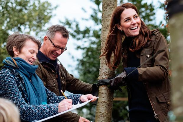Kensington Palace handout photo dated February 2019 of the Duchess of Cambridge with Andree Davies (left) and Adam White (centre), of Davies White Landscape Architect, discussing plans for her