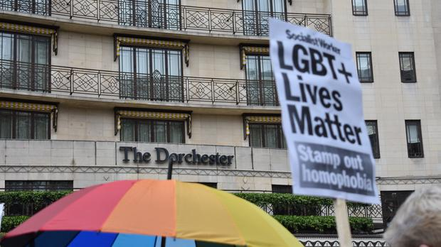 Protestors outside The Dorchester hotel on Park Lane, London demonstrating against the Brunei anti-gay laws.