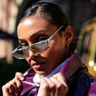 Borsha Kabir wearing Attik sunglasses and an Asos purple trench coat at Mercedes-Benz Fashion Week Resort 20 Collections on May 14, 2019 in Sydney, Australia. (Photo by Mackenzie Sweetnam/Getty Images)