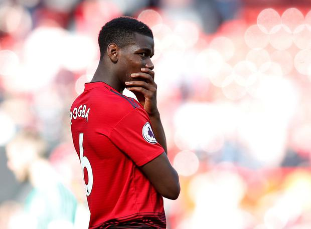 Manchester United's Paul Pogba looks dejected after the match