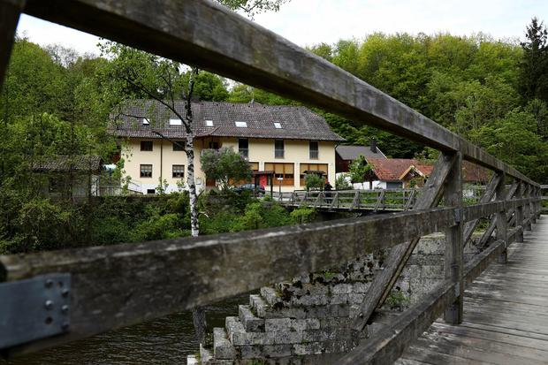 Police investigating the deaths of three people whose bodies were found with crossbow bolts inside the hotel in Bavaria on Saturday (AP Photo/Matthias Schrader)