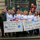 Members of the 'Enough is Enough Every Voice Counts Campaign' at a recent Dáil protest demanding equal access to education for children with autism, intellectual disability and other complex needs. Photo: Gareth Chaney, Collins