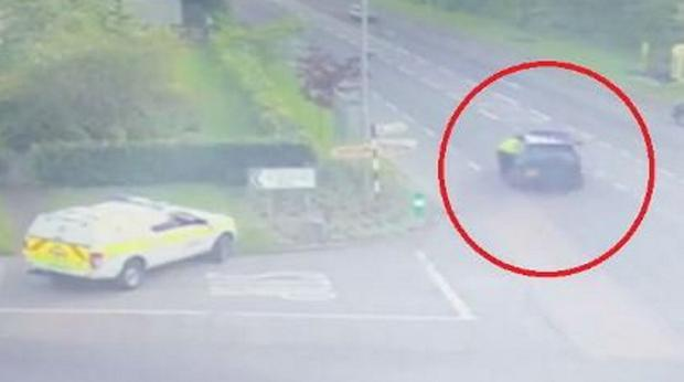 Terrifying: A CCTV still shows the garda being dragged helplessly alongside the car as it drives away