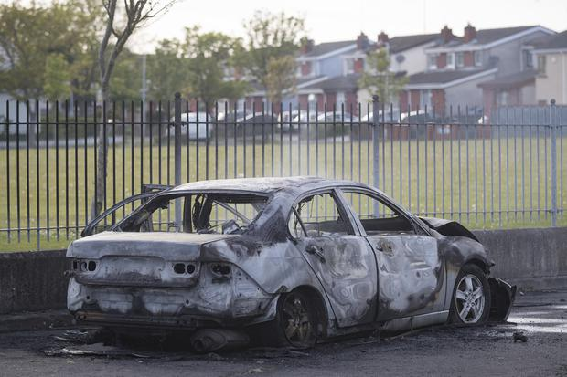 A burnt out car discovered at Kilfenora Drive. Picture: Arthur Carron