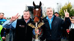 Michael O'Leary (right), Gordon Elliott and Tiger Roll. Photo: Brian Lawless/PA