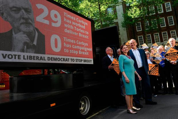 Campaign: Liberal Democrat MPs Jo Swinson and Ed Davey launch a new poster attacking Labour Party leader Jeremy Corbyn's approach to Brexit. Photo: Getty