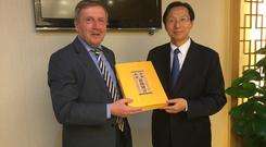Minister for Agriculture Food and the Marine Michael Creed with Minister for Agriculture and Rural Affairs Han Changfu.