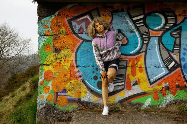 Purple retro floral half-zip top with front pocket, €30, marl grey hoodie, €25, black cycle shorts with colour panel detail, €20