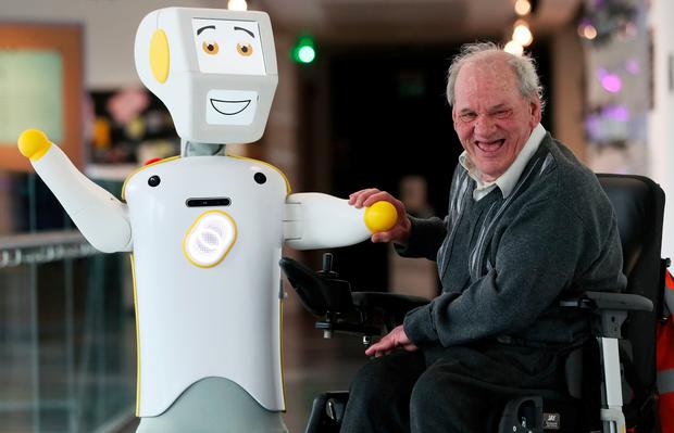 IrelandÕs first socially assistive AI robot 'Stevie II' from robotics engineers at Trinity College Dublin, with Brendan Crean, who helped trial the robot through the charity ALONE, during a special demonstration at the Science Gallery in Dublin. Brian Lawless/PA Wire