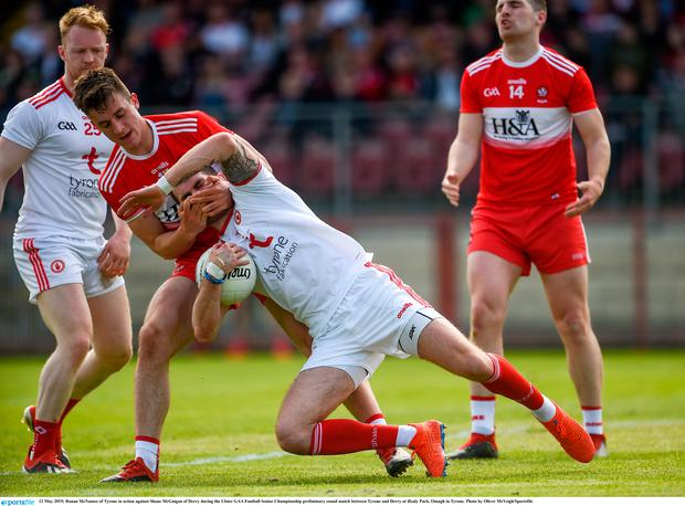 Ronan McNamee of Tyrone in action against Shane McGuigan of Derry during the Ulster GAA Football Senior Championship preliminary round match between Tyrone and Derry at Healy Park, Omagh in Tyrone. Photo by Oliver McVeigh/Sportsfile