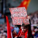 A Liverpool fan holds up a sign at Anfield last weekend. REUTERS/Phil Noble