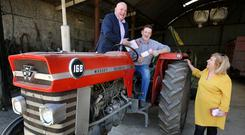 Ploughing for votes: Mark Wall (left) and Aoife Breslin canvassing Seamus Harris, from Ballyroe Churchtown. Photo: Steve Humphreys