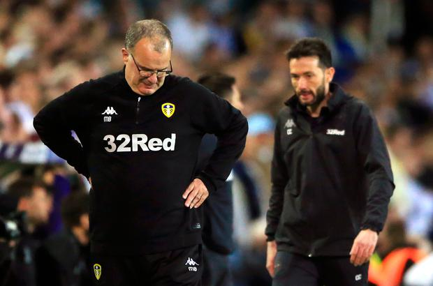 Leeds United manager Marcelo Bielsa (left) appears dejected during the Sky Bet Championship Play-Off, Semi Final, Second Leg match at Elland Road, Leeds. Nick Potts/PA Wire.