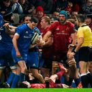 Sexton leaves his Munster rival on the ground in last December's derby clash. Photo: Diarmuid Greene/Sportsfile