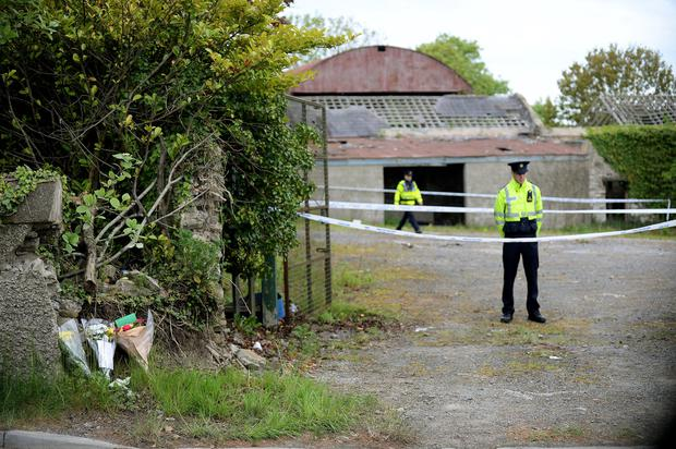 Flowers placed at scene of the farmhouse where the body of Ana Kriegel was found