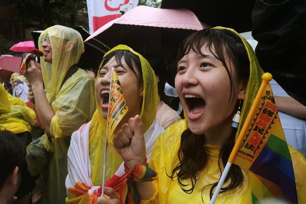 Same-sex marriage supporters shout during a parliament vote on three draft bills of a same-sex marriage law, outside the Legislative Yuan in Taipei, Taiwan May 17, 2019. REUTERS/Tyrone Siu