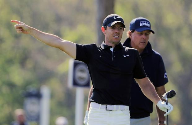 Rory McIlroy, of Northern Ireland, motions after driving off the 12th tee during the second round of the PGA Championship golf tournament, Friday, May 17, 2019, at Bethpage Black in Farmingdale, N.Y. (AP Photo/Charles Krupa)