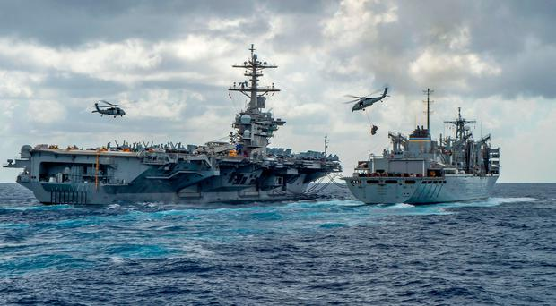 The aircraft carrier USS Abraham Lincoln refuels in the Arabian Sea. Photo: AFP/Getty