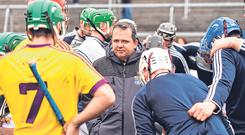 Davy Fitzgerald with his Wexford team before their League quarter-final defeat to Galway in March. Photo: Sportsfile