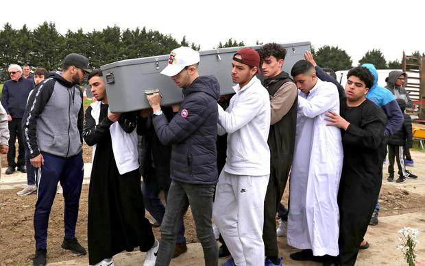 The coffin of Azzam Raguragui is carried by his friends. Photo: Colin Keegan