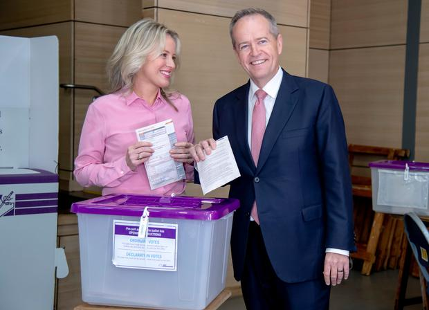 Australian opposition leader Bill Shorten poses as he votes with his wife Chloe (AP Photo/Andy Brownbill)