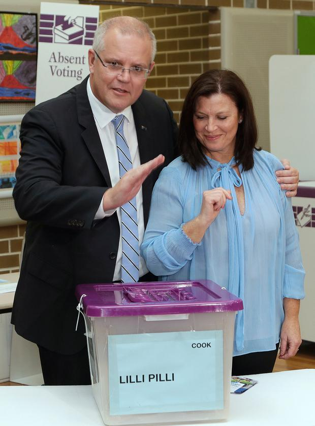 Australian Prime Minister Scott Morrison with his wife Jenny as he casts his ballot in a federal election in Sydney (AP Photo/Rick Rycroft)
