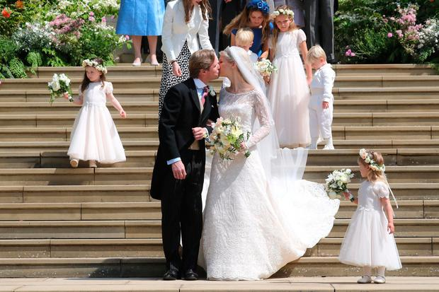 Newlyweds Thomas Kingston and Lady Gabriella Windsor share a kiss on the steps of the chapel after their wedding at St George's Chapel in Windsor Castle. Photo: Chris Jackson/PA Wire
