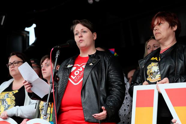 Sara Canning (centre), partner of murdered journalist Lyra McKee, speaking in Belfast city centre during a march demanding same sex marriage in Northern Ireland. Photo: Brian Lawless/PA Wire