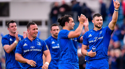 Robbie Henshaw of Leinster, right, shows his appreciation to fans