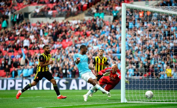 Manchester City's Raheem Sterling scores his side's sixth goal of the game during the FA Cup Final at Wembley Stadium. Photo credit: Nick Potts/PA Wire.