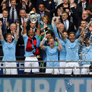 Wembley Stadium - May 18, 2019 Manchester City's Vincent Kompany lifts the FA Cup as he celebrates winning the final with team mates. REUTERS/Toby Melville