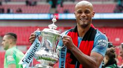 Manchester City's Vincent Kompany celebrates with the trophy after winning the FA Cup REUTERS/David Klein