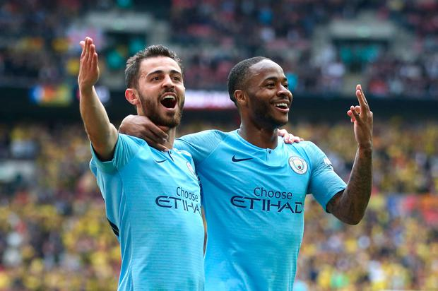 Raheem Sterling celebrates after scoring City's fifth goal with Bernardo Silva during the FA Cup final. Photo: Alex Morton/Getty Images